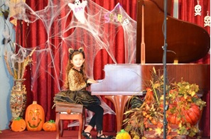 A young Ashley Dixon performs at the Little Chopin Halloween recital